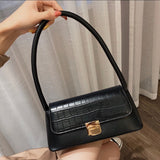 Trapeze buckle shoulder bag in black - CURATED by FS