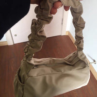 Nylon ruffle shoulder bag in cream - CURATED by FS