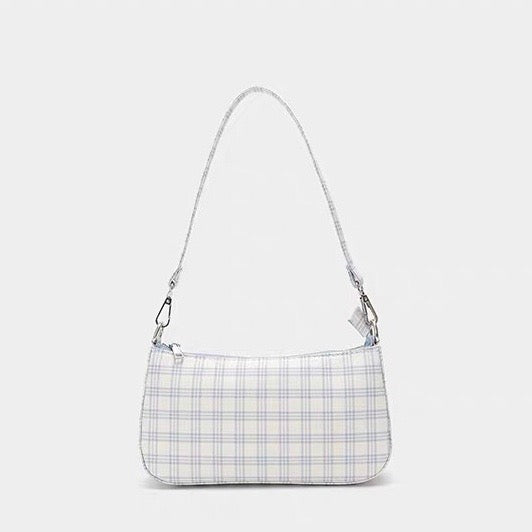 Plaid shoulder bag in cream - CURATED by FS