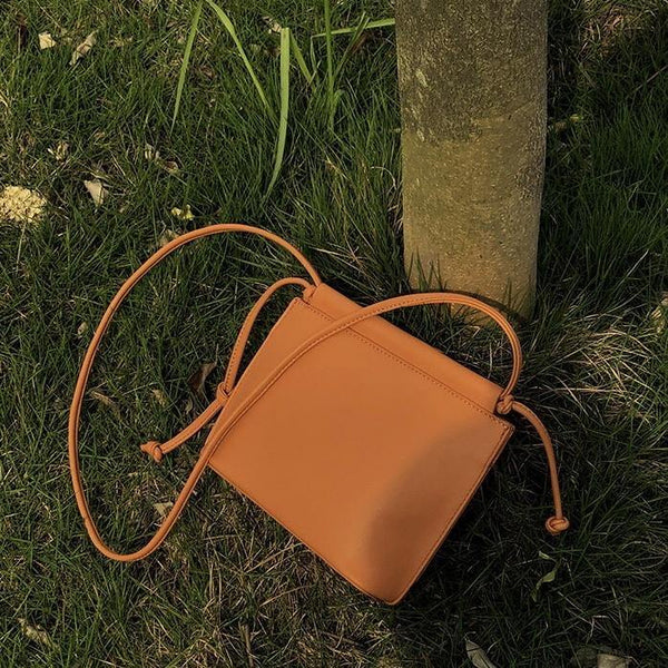 Envelope crossbody bag in tan - CURATED by FS