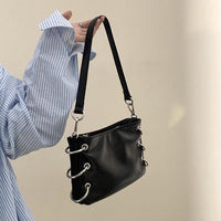 Envelope shoulder bag with rings detail - CURATED by FS