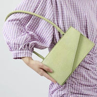 Lizard effect shoulder bag in lilac - CURATED by FS