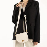 Mini saddle crossbody bag in cream - CURATED by FS