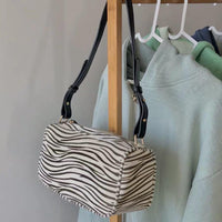 Zebra print shoulder bag - CURATED by FS
