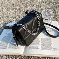 Mini quilted chain crossbody bag in black (more colors)