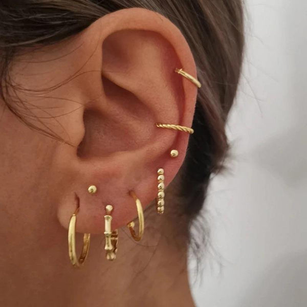 Gold plated bamboo huggie earrings