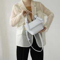 Knotty trapeze day bag in light grey - CURATED by FS
