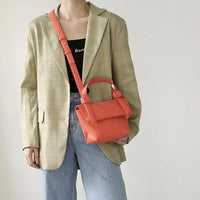 Knotty trapeze day bag in tomato red - CURATED by FS