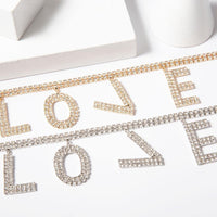 """LOVE"" rhinestones dangles choker necklace in gold tone - CURATED by FS"