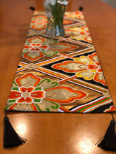 Load image into Gallery viewer, Table Runner in gold on black Hanabishi motif with black tassels.