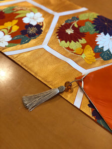 Table Runner in gold with a Hanamaru (flower circles) pattern on a turtle shell motif.