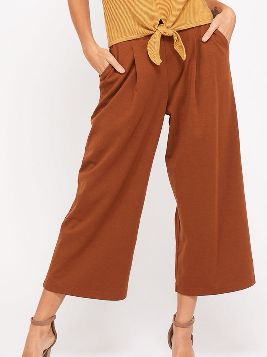 These breezy, knit pants are a must have fall essential! They are effortless, with a wide elastic waist band and pockets they will be a grab everyday pant. Dress them up or down, you can't go wrong.  Fit is true to size. 65% RAYON 30%Polyester 5%spandex