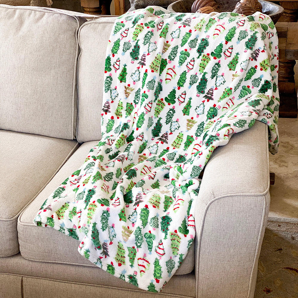 Joyful and colorful hand-drawn Christmas trees feautring varying colored and shaped ornaments or garland cover this ultra plush holiday throw