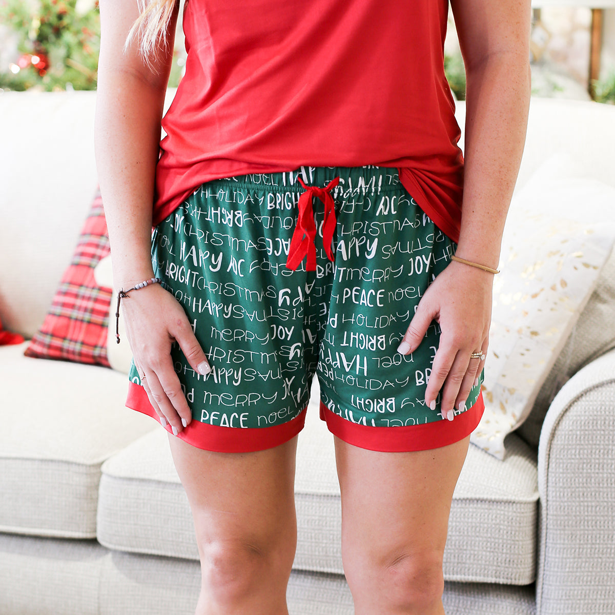 The perfect sleep shorts to get in the holiday spirit! These festive plaid sleep shorts are perfect for watching holiday movies, opening gifts on Christmas morning and so much more! Material: 95% Polyester, 5% Spandex Runs true to size, model is wearing a size