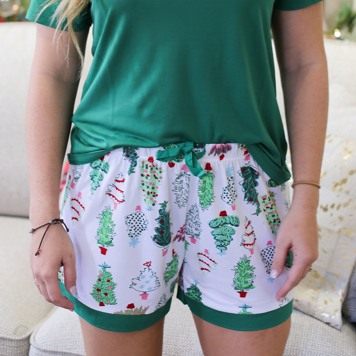 The perfect sleep shorts to get in the holiday spirit! These Treeful sleep shorts are perfect for watching holiday movies, opening gifts on Christmas morning and so much more!  Material: 95% Polyester, 5% Spandex Runs true to size, model is wearing a size