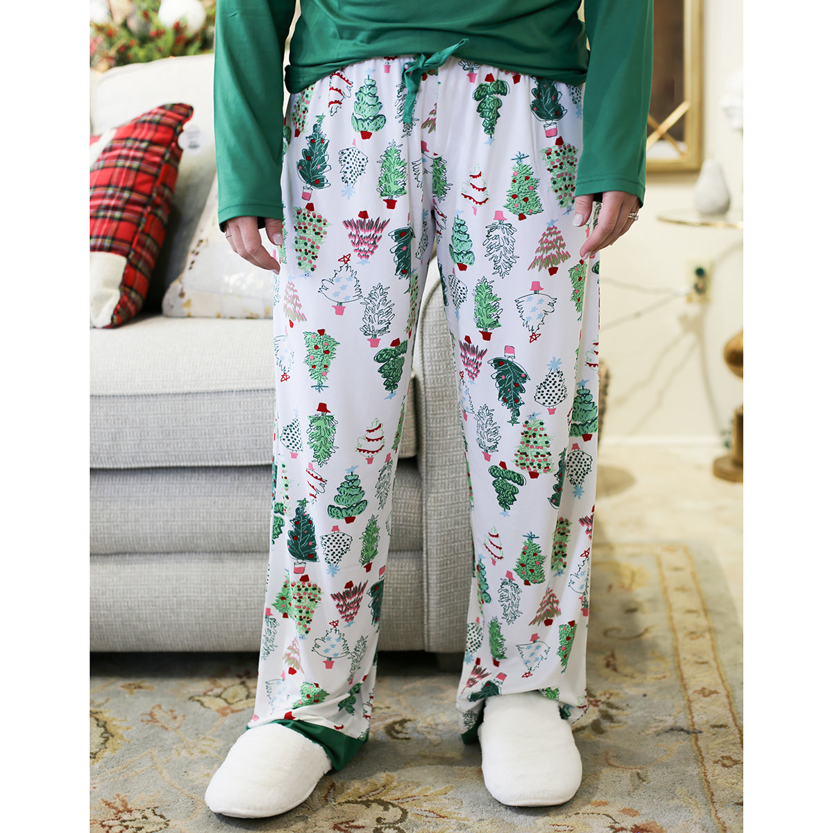Ho Ho Ho! These Treeful Sleep Pants are perfect for your Christmas morning and all holiday long.    Material: 95% Polyester, 5% Spandex Runs true to size, model is wearing a size