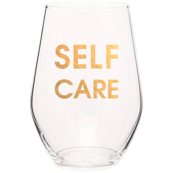 "Crush your wine in style with our ""Self Care"" gold foil stemless wine glass. Wine glasses are printed in Los Angeles.   19 oz. American made stemless wine glass Gold Foil Imprint Hand wash only"