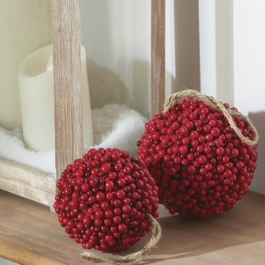 A Christmas classic, berries are synonymous with the season. This faux red berry ball ornament adds the perfect spray of color to your tree, or place on a tabletop to add a touch of classic color to your holiday displays. Made of quality foam material with red berry exterior Ornament measures approximately 5 inches in diameter Perfect for displaying on a Christmas tree or ornament stand as a holiday accent piece