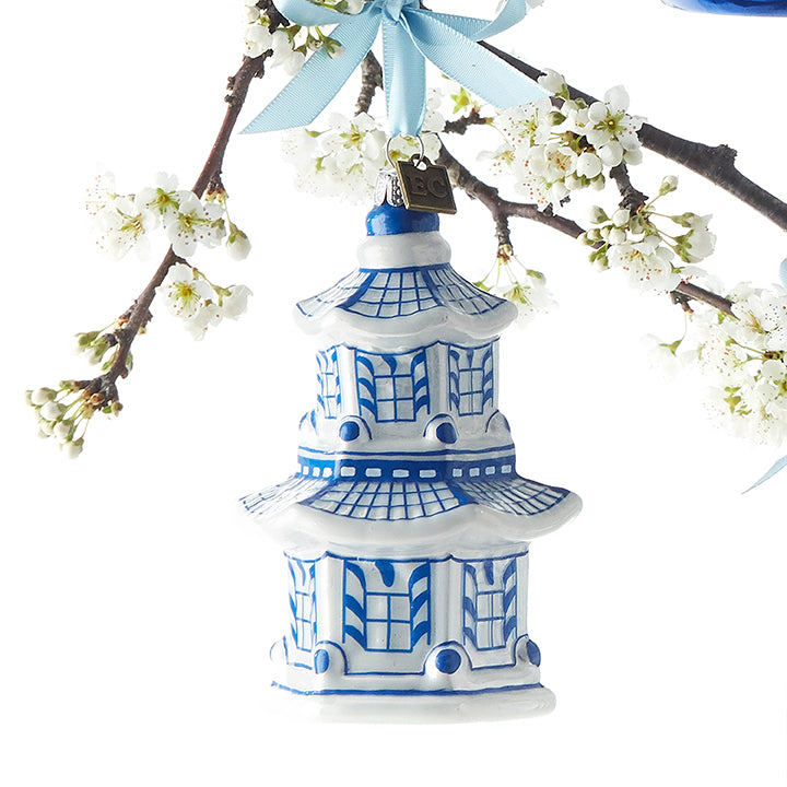 Calling all chinoiserie lovers! This stunning pagoda replica It is painted with gorgeous blue colors and is sure to compliment your tree beautifully!   Made by Raz Imports.  Made of glass.  Dimensions: 4.25""