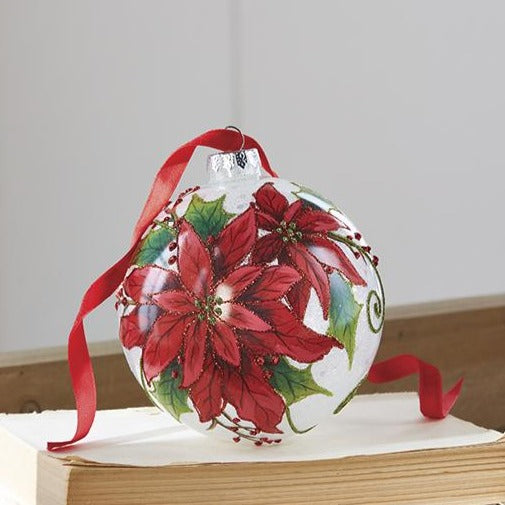The traditional flower of the season, the poinsettia is a classic. Beautiful red blossoms and green leaves with touches of red sparkle on this Poinsettia Ball glass ornament make this a keepsake for all Christmases to come.   Made of glass. Approximately 5 in. in diameter.