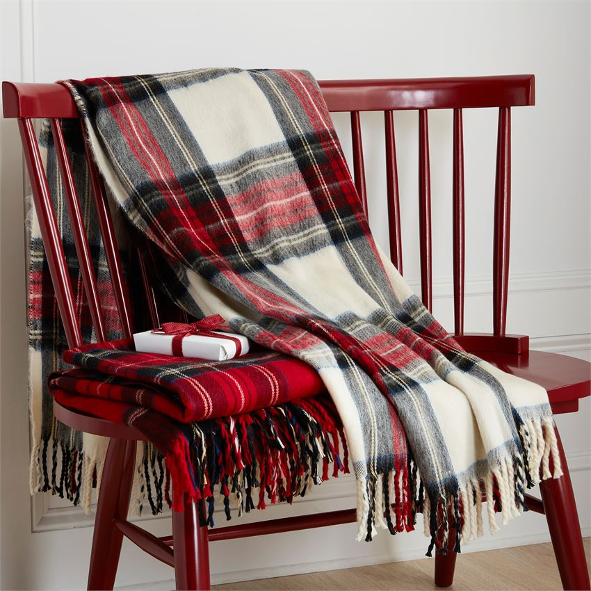 "This classic plaid, festive throw is just right for snuggling up on a sofa or armchair, especially when the weather is cold outside.  Choose from white or red tartan throw. Sold individually.  Soft tartan throw with fringe trim Dimesnsions: 50"" x 60""  Material: cotton  Imported"