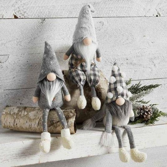 "A holiday folklore favorite, these decorative gnomes will add a whimsical touch to your holiday decor. Known for guarding their treasures, these festive friends will keep watch of Santa's haul and delight your family all season long. A modern take on the elf on the shelf tradition.  Size: 9"" x 4"" Each Each Gnome is weighted for easy sitting.  Sold individually - choose from fuzzy hat, pom hat or felt star hat."