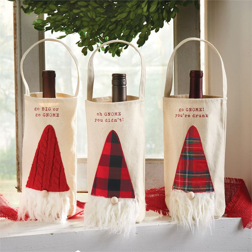 "Bring a touch of holiday whimsy when you use these gnome bottle bags to decorate or gift your favorite vintage. Fun and festive for any holiday occasion. These gnome wine bottle bags features faux fur beard and wooden nose. Choose from: red knit ""Go Big or Go Gnome"", buffalo check ""oh Gnome you didn't"", or red plaid ""go Gnome you're drunk"". Size: 10"" x 6"" Material: CANVAS"