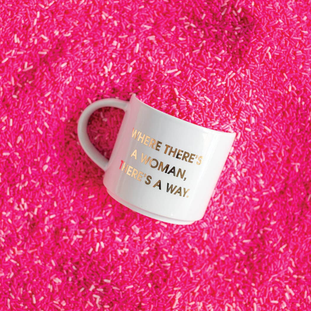 "Start your day with some fun! This ""Where There's A Woman There's A Way"" gold foil imprint mug from Chez Gagne is perfect for your coffee, tea or wine.  Oversize 16oz. Ceramic Mug Gold Foil Lettering Stackable Hand Wash Only. Do Not Microwave."
