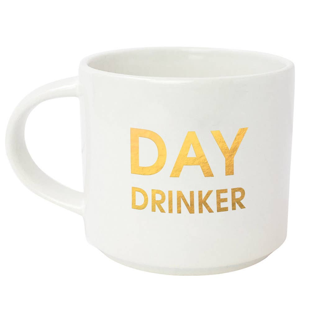 "Start your day with some fun! This ""Day Drinker"" gold foil imprint mug from Chez Gagne is perfect for your coffee, tea or wine.  Oversize 16oz. Ceramic Mug Gold Foil Lettering Stackable Hand Wash Only. Do Not Microwave."