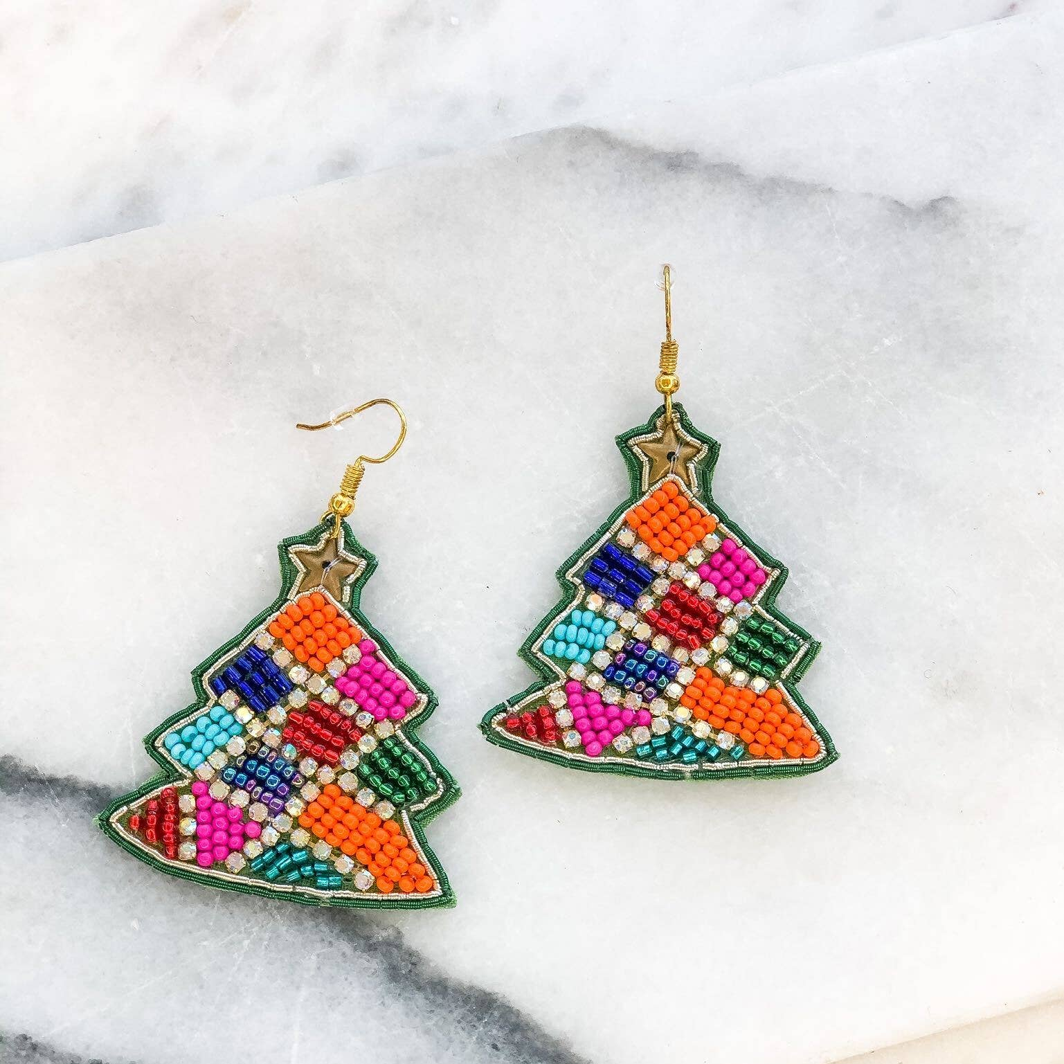 Fun and festive beaded Christmas tree earrings.   2.5 in long.