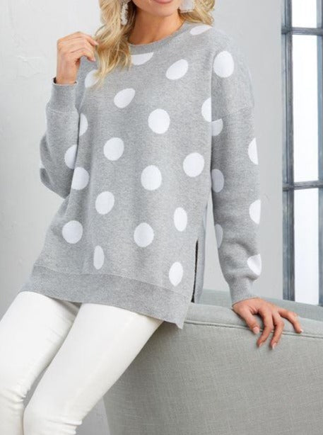 Perfectly Dotted To Perfection this oversized sweater will keep you cozy this winter. The oversized polka dots make this a fun pairing with your favorite white denims, or pop it over leggings for a cute lounge around look.  Runs extremely big. Size down.  100% ACRYLIC Machine wash.