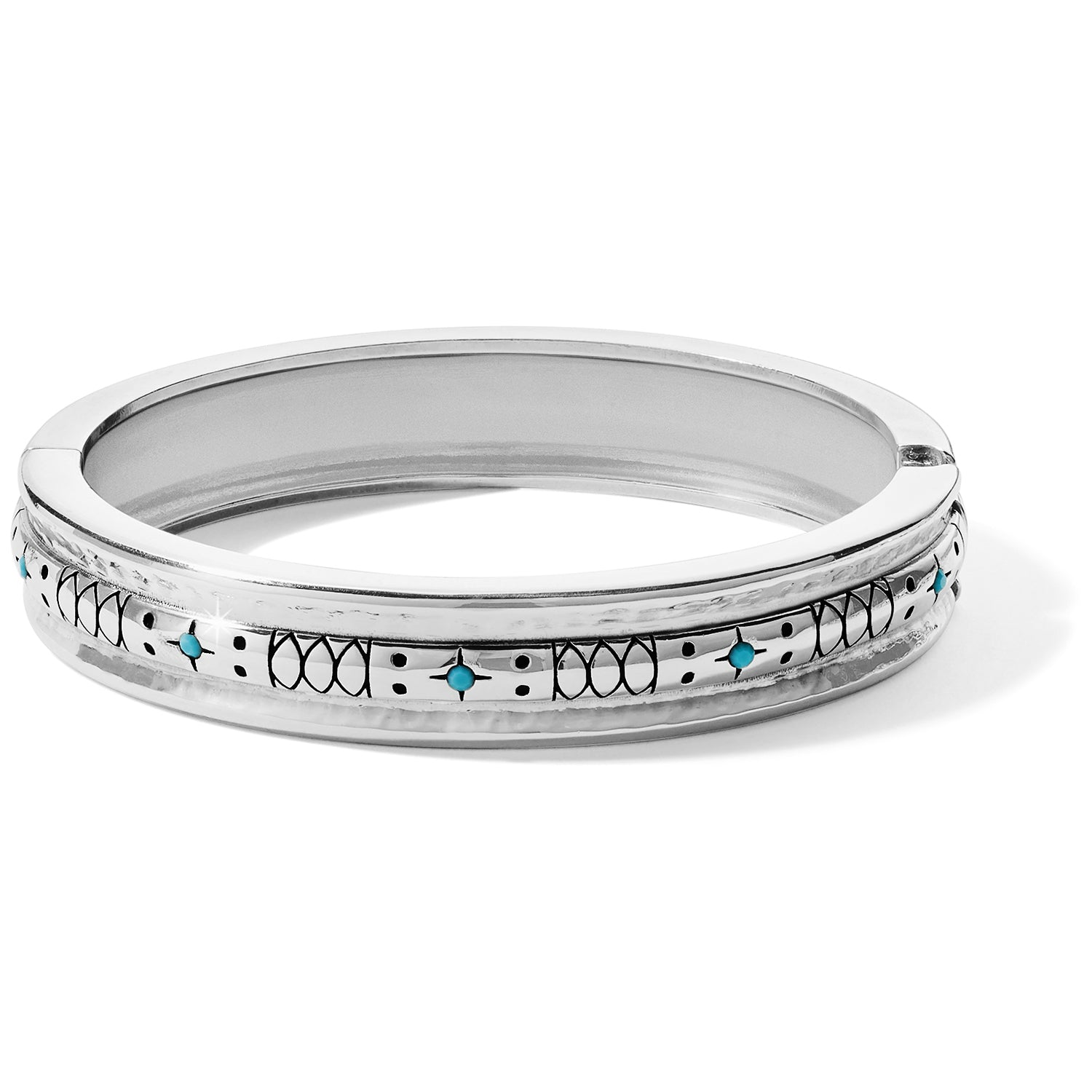 "The Brighton Marrakesh Mystique Hinged Bangle is a silver etched hinged bangle accented with turquoise colored stones is perfect to wear alone or stack with other textured bangles. Width: 1/2"" Closure: Hinged Diameter: 2 3/8"" Finish: Silver plated Features: Turquoise"