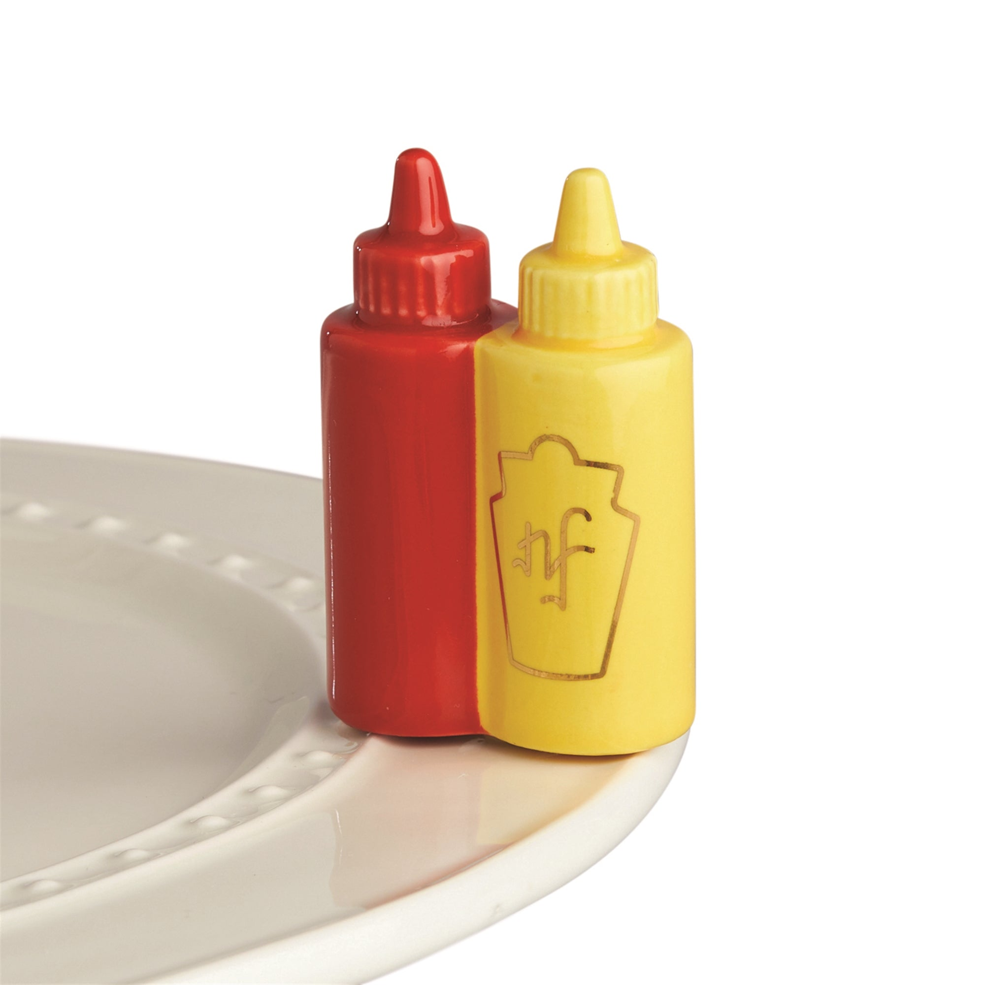 "For the cutest cookout on the block, just add this Nora Fleming Main Squeeze Mini! You'll love the gold ""nf"" emblem on both the sunny yellow mustard and the jubilant red ketchup! Add a colorful mini to any Nora Fleming stoneware, wood, or melamine base piece! Hand-painted and as sweet as can be - once you get one, you'll want mini, mini more!"