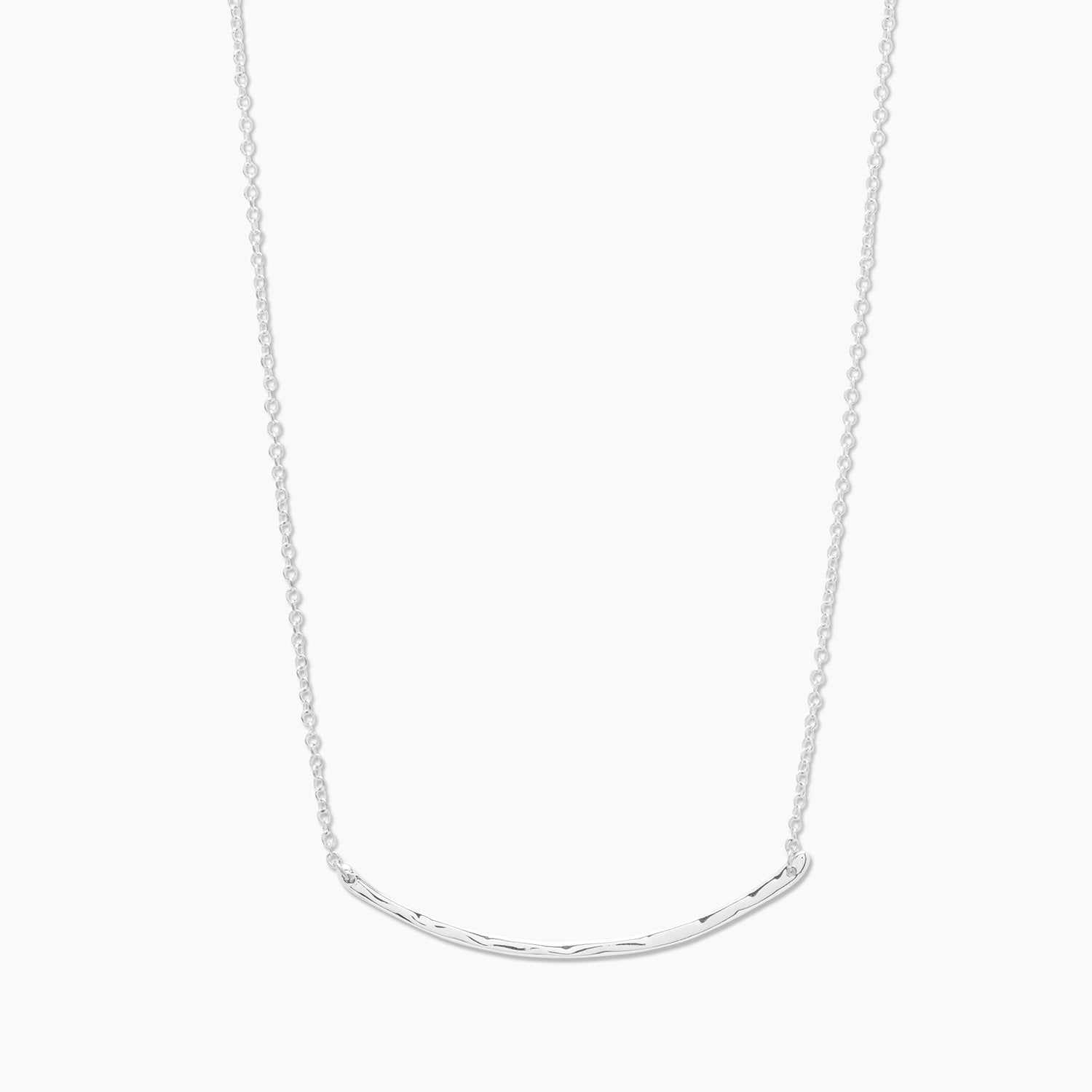 Comfortably lightweight and layerable, this hammered-bar necklace is plated in shiny precious metal. Bar measures 2 1/8'' across Chain measures 14'' Spring ring closure Avoid contact with anything containing derivatives of alcohol