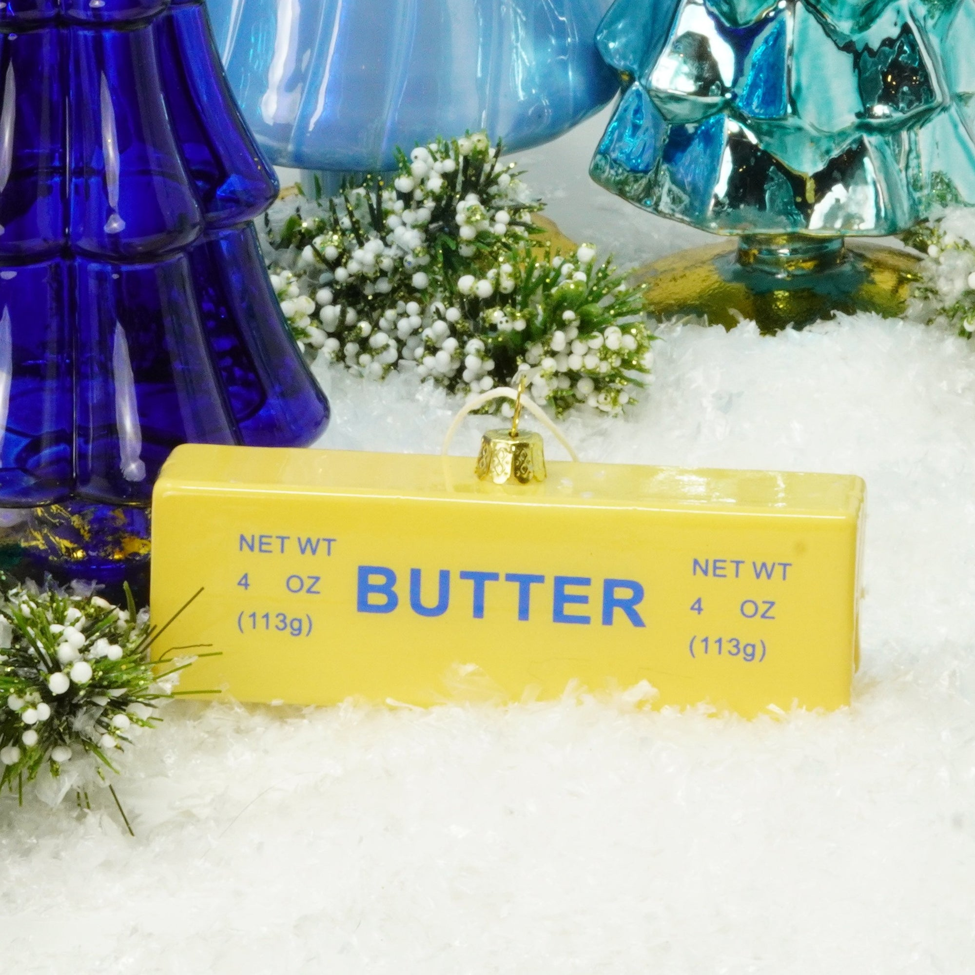 There is only one universal truth in life, and here it is: Everything is better with butter! You know we're right, which is why you're about to buy this clever little Stick of Butter Glass Christmas Ornament! It's the perfect stocking stuffer for the baker in your life, or for anyone who—like us—will sing butter's praises to the end of the earth!