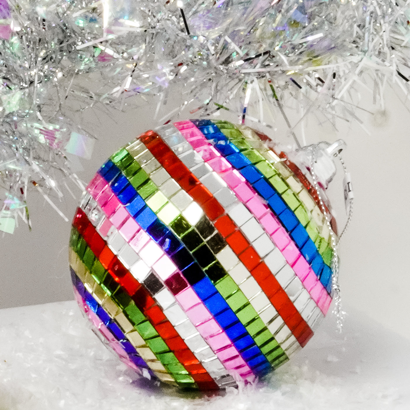 Bring back the 70's vibe with Multi-Color Rainbow Mirror Disco Ball Christmas Tree Ornament.