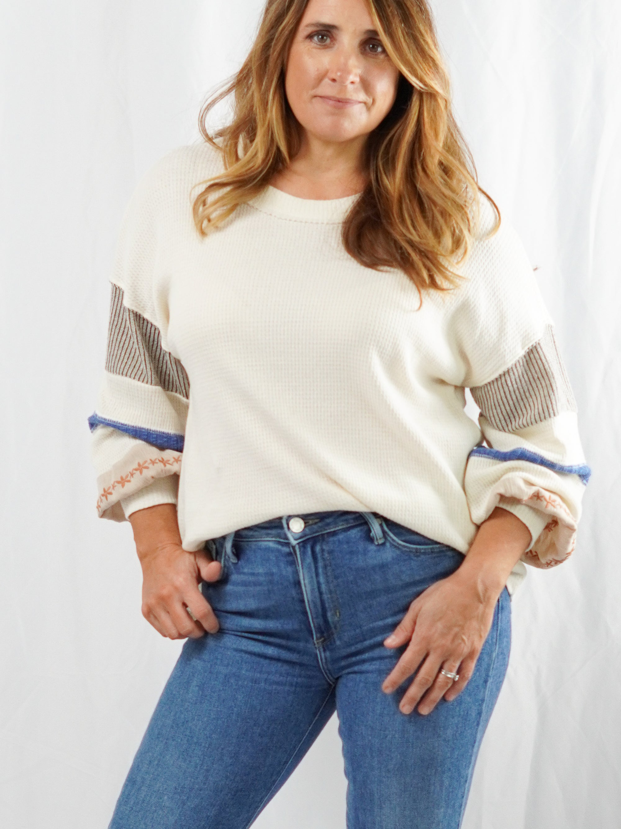Every girl is going to wish she had your top! This knit top can be paired with your favorite denim bottoms for a day around town or a day of leisure. The denim and earth tone stripes are a perfect transition to Fall.   Model is wearing a size S Generous cut and a boxy fit (If tall size up for length).
