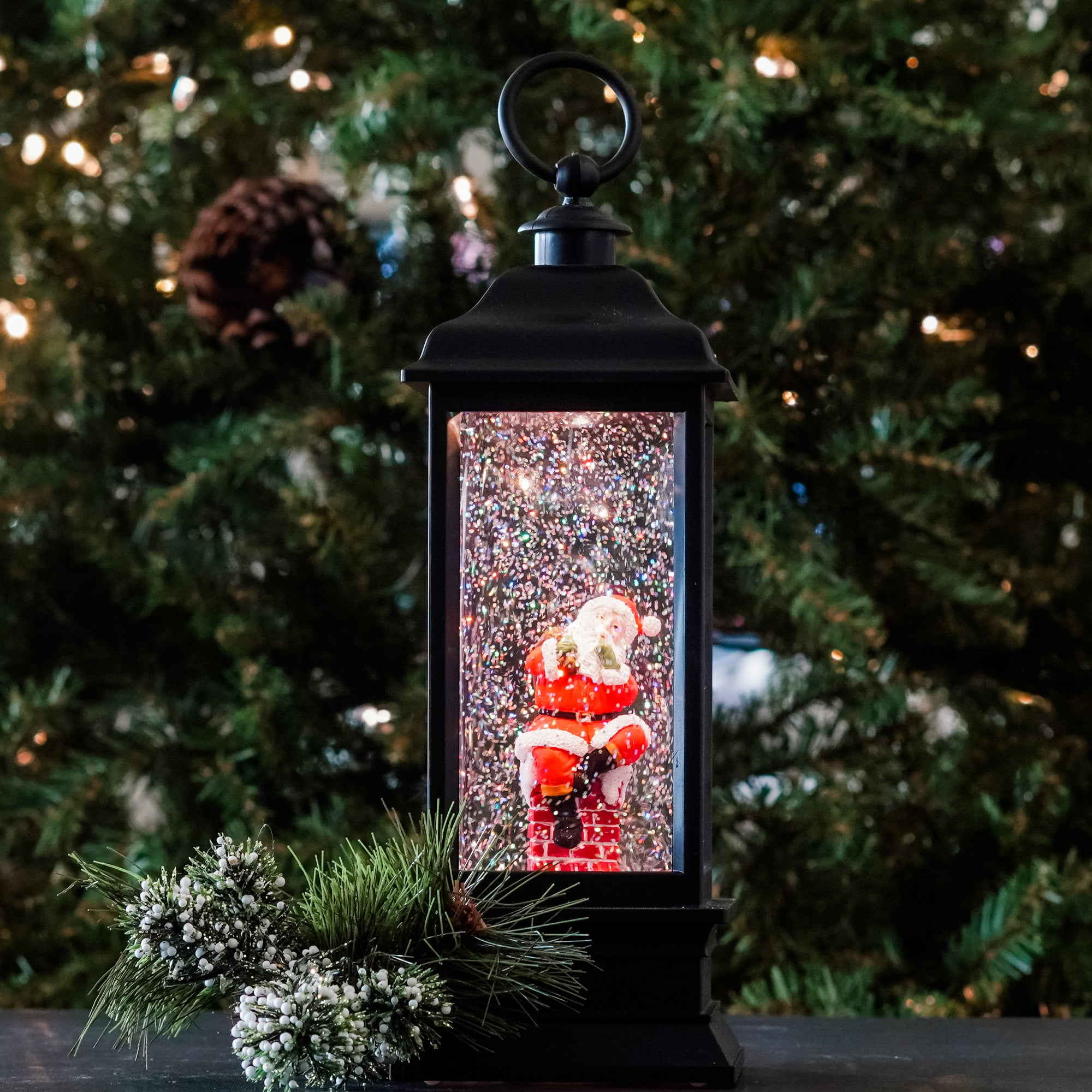 Santa's getting ready to visit all. Inside this LED water lantern. Santa is holding his bag of toys and gifts ready to come down the chimney with swirling glitter, when turned on a warm LED shines down on the figurine to give our water lantern a whimsical look for the Christmas Holiday season. NEW for 2020!