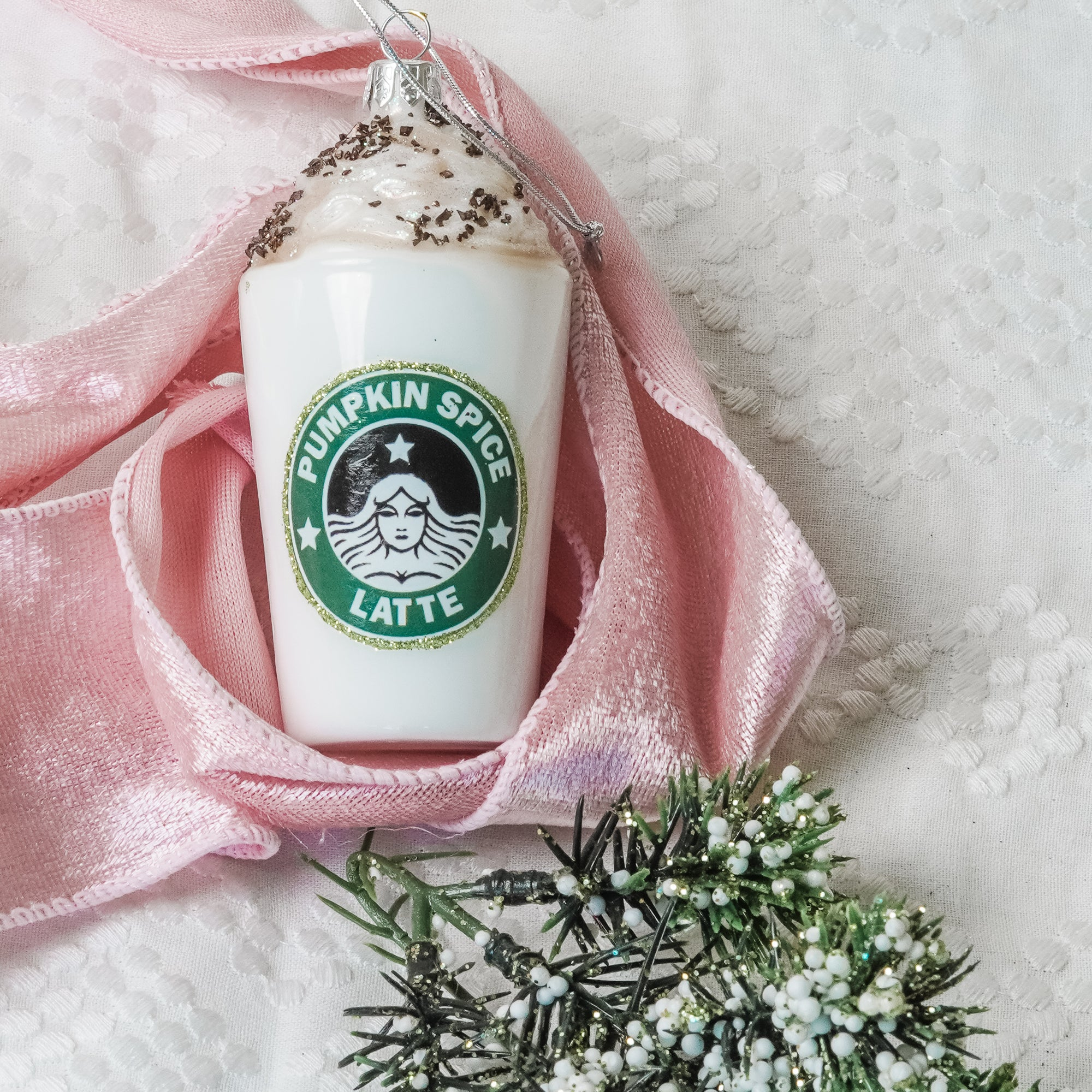"Calling all PSL lovers! A holiday treat like no other, this Pumpkin Spice Latte Keepsake Ornament is the perfect gift for the coffee lover.   4"" tall, 2"" diameter, 1.0 ounce size excludes 3/8"" metal wire hanger ring at the top"