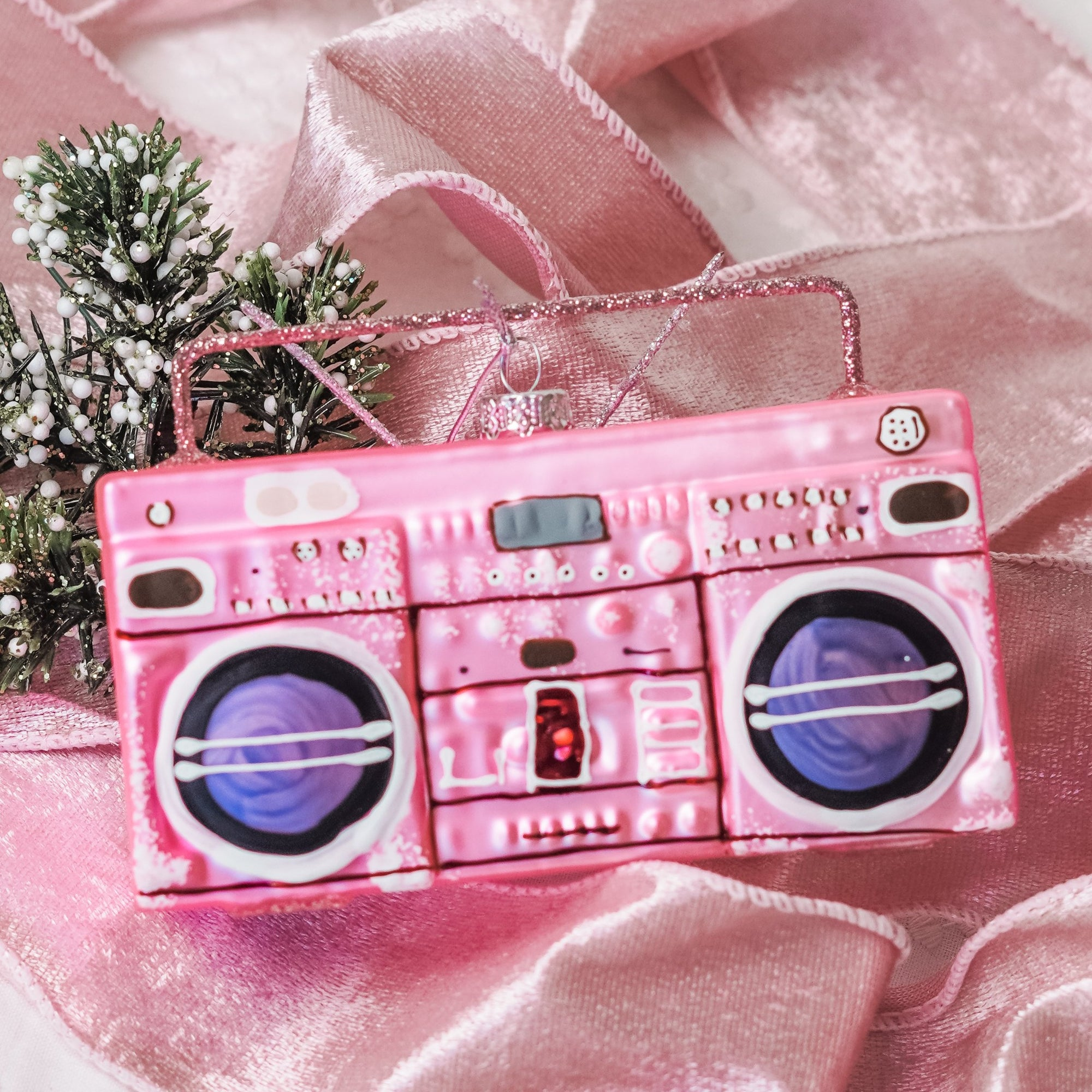 Remember when you and your girlfriends got your groove on to tunes booming out of your boombox? Celebrate the season with this nostalgic Boombox Ornament in Pink - a wonderful addition to your Christmas ornament collection this year!  Approximately 5 in. wide by 3 in. tall Made of glass.  Imported.