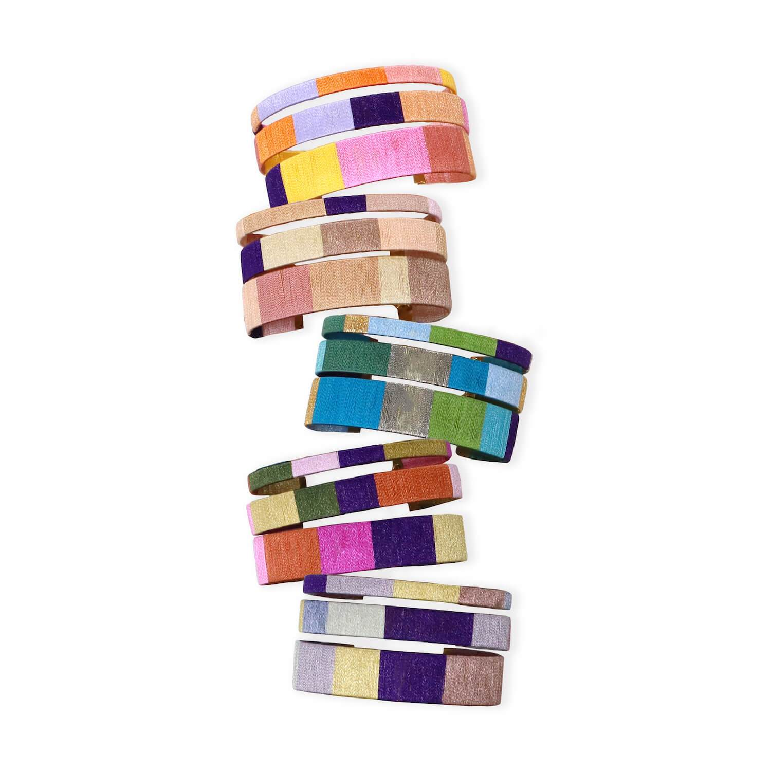 One of our newest obsessions, we love these new cuff bracelets from BuDhaGirl and the thoughtfulness behind them. Handcrafted in India, these delightfully flexible set of 3 cuffs are wrapped in cotton thread in the most beautiful color combinations.