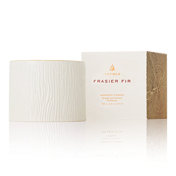 This aromatic candle features stunning wintery white wood grain ceramic, trimmed with a 24-karat gold rim. The fresh, just-cut forest fragrance of Frasier Fir fills any room with warmth and elegant ambiance.  Non-metal wick provides a clean, pure burn. Approximately 45 hours.