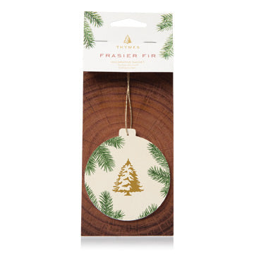 A new spin on a class favorite - this seasonal sachet has been redesigned to add a touch of style and a hint of fragrance to common or surprising spaces. Now with a round shape & classic pine needle design, the warm, comforting scent of Frasier Fir is the perfect stocking stuffer or gift tag.