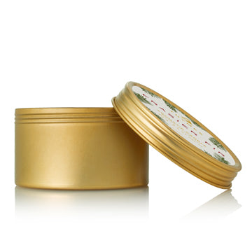 Bring your holiday traditions wherever you go. This perfectly-sized gold travel tin candle allows you to bring the crisp scent of Siberian Fir needles, heartening cedarwood and relaxing sandalwood with you anywhere you go to fill smaller spaces.  Non-metal wick provides a clean burn. Burn time of approximately 16 hours. 2.5 oz.