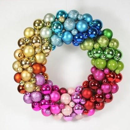 Merry colorful! This fun and festive wreath is made of shimmering, multicolored, multisized matte and shiny baubles to create an undulating bright, happy wreath.   15 in. diameter Made of acrylic.