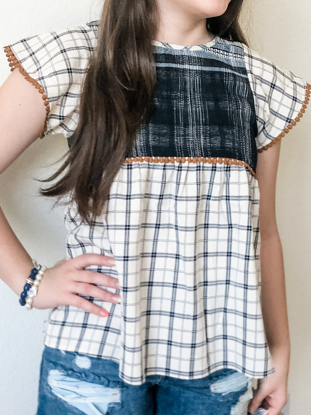 You know you have a plaid habit and this top is the perfect fix! The ivory and navy hues top features a plaid bottom, knit top, and amber detailing on the sleeves. Pair with your favorite jeans and get ready to rock your plaid!