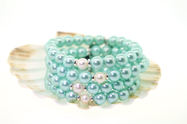 Aqua Pearl Stacker. The gem of the sea, aqua pearls are known to symbolize new beginnings, prosperity, love, and inner beauty.