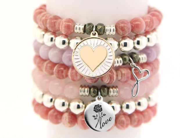 No beauty shines brighter than that of a good heart. This charm is a symbol of love, kindness, compassion and positivity. Wear this bracelet as a reminder to see the beauty in and all around you.  Each beaded Heart of Gold charm bracelet is accented with two Pyrite stones worn to bring good luck and good fortune to the wearer.