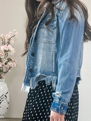 Finding a best friend is hard. Not once you put this distressed denim jacket on. It's so soft you will feel like you are wearing your most comfy pjs! Fitted from top to bottom, this light wash cropped style includes a minimal distressing and uneven frayed hems, along with double pocket details.