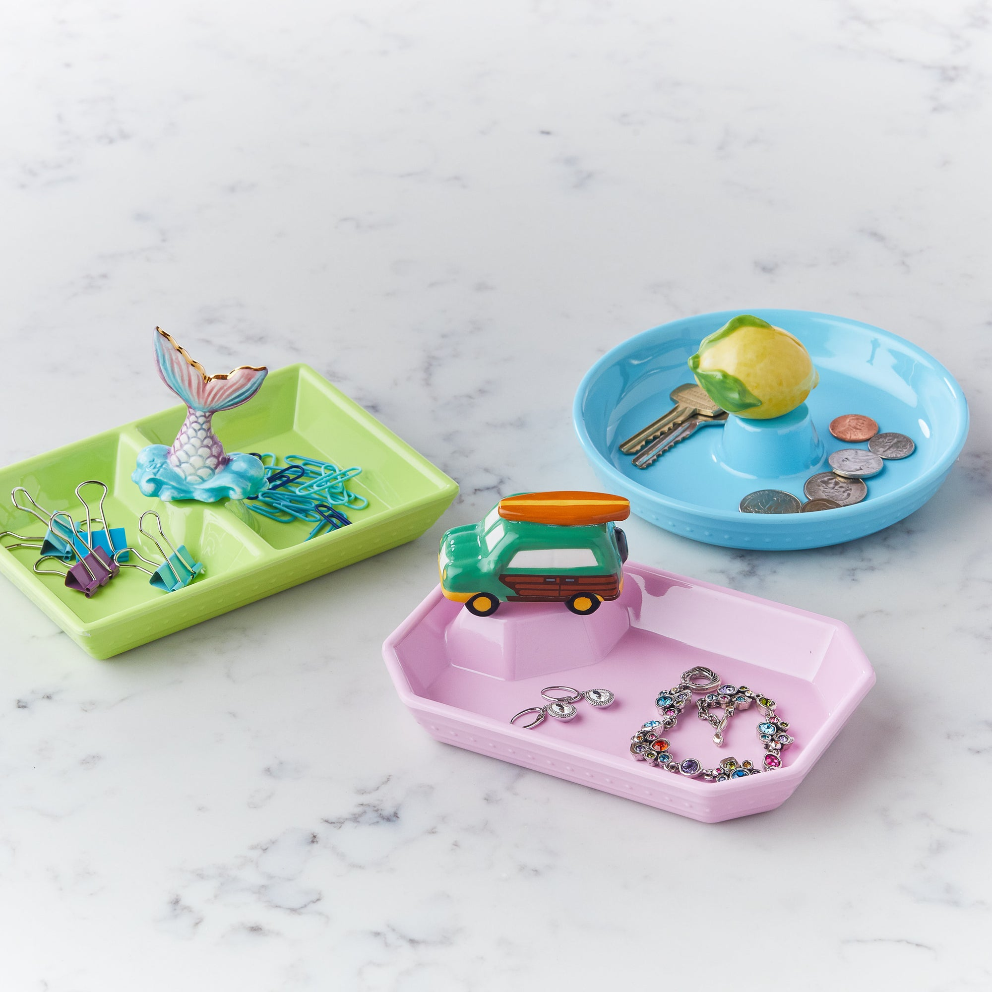 These colorful dishes will bring some cheer to your organizational tendencies! Keep candy, keys, business cards, slices of lemon and lime! you name it, the dainty dishes will hold it! And they look so cute with all the new minis!